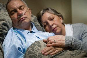 Old couple sleeping together man nasal cannula
