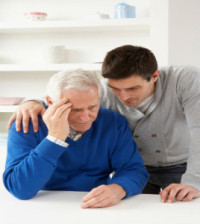 Grown Up Son Consoling Senior