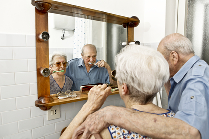 elderly couple washing teeth