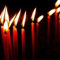 Red candles in a row glowing