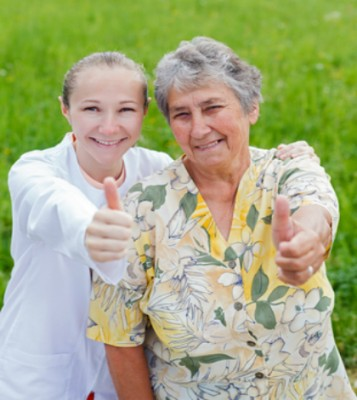 caregiver and senior woman support